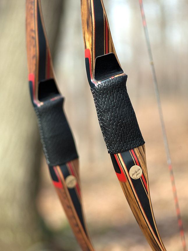 Detail of the take-down longbows, PL-X, in Tiger Myrtle (foreground) and Honduran Rosewood.