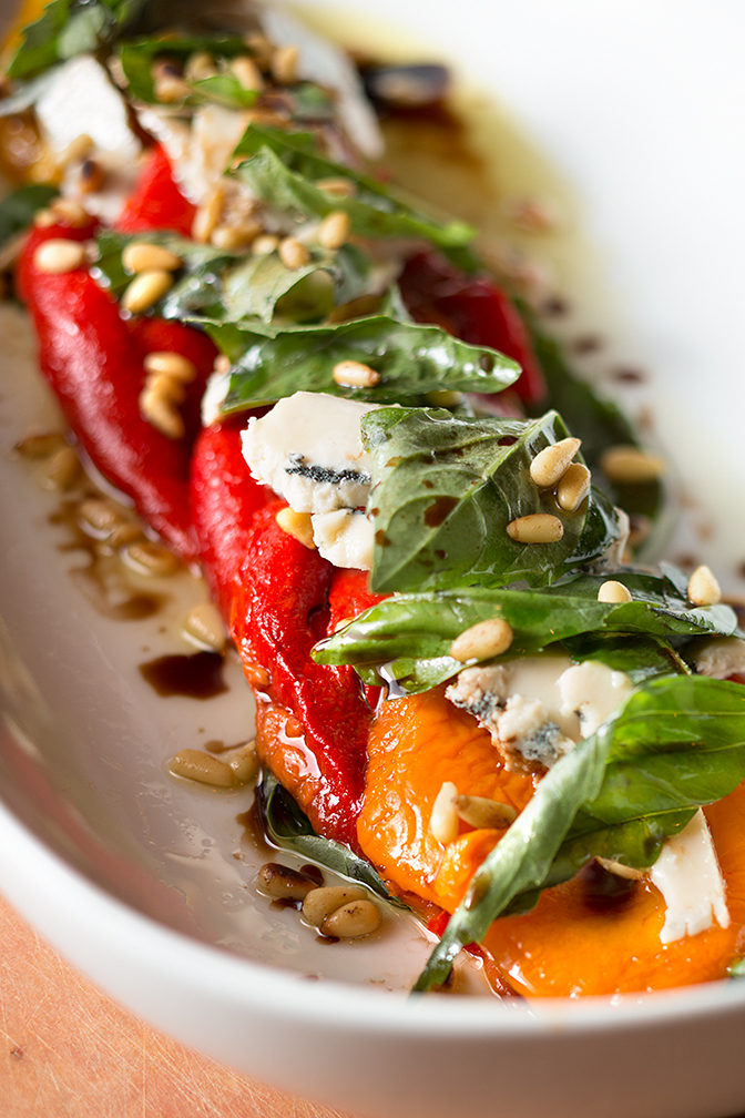 Roasted peppers and pine nuts with basil, an incredible gorgonzola, and balsamic / oil drizzle! Gorgeous!