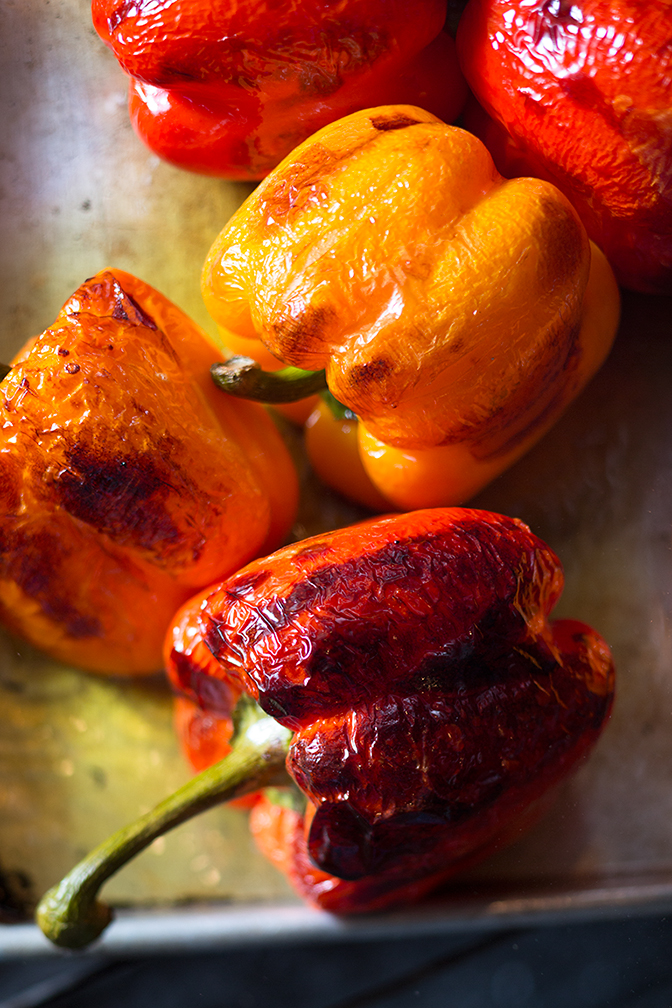 A pan of freshly-roasted peppers, just pulled from the oven, and still sizzling. Whoa.