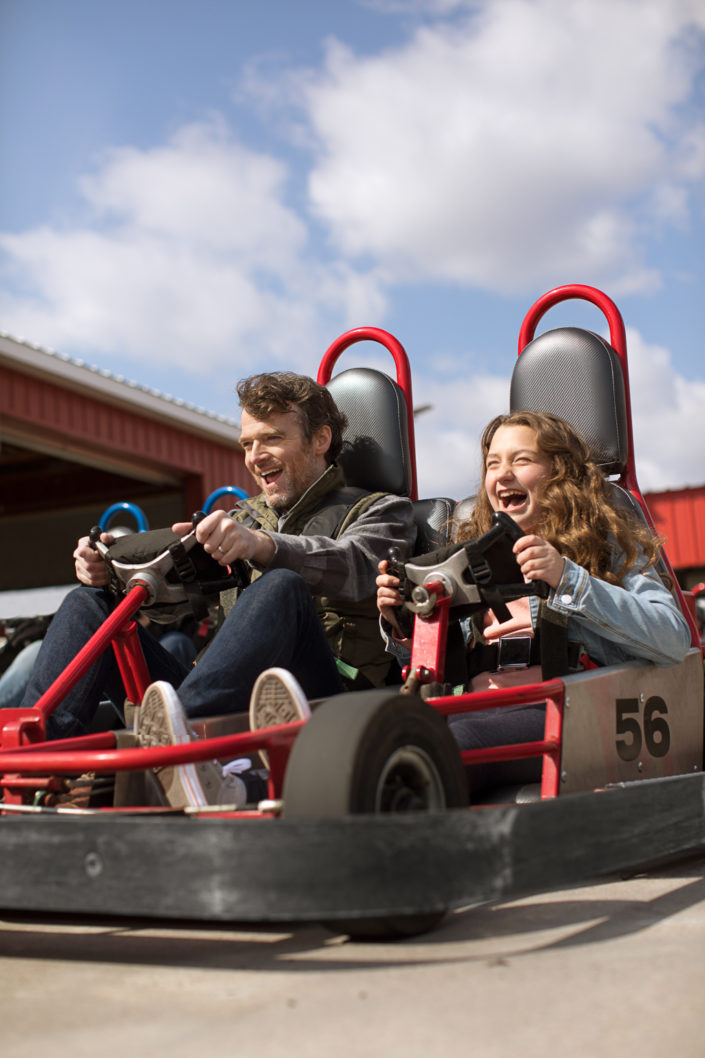location photography, lifestyle photography, outdoor photography, father and daughter, amusement, fun, go-kart, fun park, race track, advertising photography, ad campaign, advertising campaign, laughter, joy, wegmans, wegmans food markets, people photography