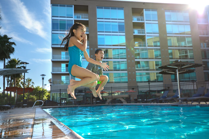 location photography, swimming photography, children swimming, kids playing, swimming pool photography, commercial photography, advertising photography, travel photography, tourism photography, travel and tourism, hotel photography, hotel pool, kids jumping in pool, kids in summer, kids swimming