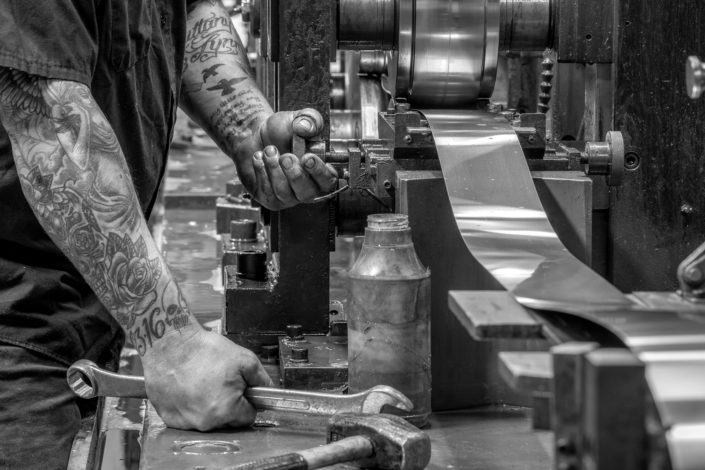 manufacturing photography, industrial photography, metal manufacture, roll forming metal, gritty photography