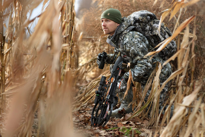 hunter with crossbow, crossbow hunting, stalking with crossbow, ravin r29 x, crossbow, ravin crossbows, velocity outdoor